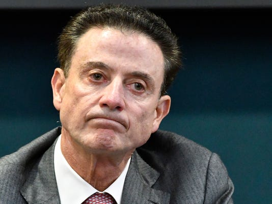 FILE - In this Oct. 20, 2016, file photo, Louisville coach Rick Pitino reacts to a question during an NCAA college basketball press conference in Louisville, Ky. Louisville announced Wednesday, Sept. 27, 2017, that they have placed basketball coach Rick Pitino and athletic director Tom Jurich on administrative leave amid an FBI probe.   (AP Photo/Timothy D. Easley, File)