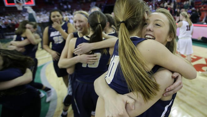 Appleton North's Anna Laux, left, and Taylor Sieg celebrate their victory against De Pere in the WIAA Division 1 girls' basketball state championship game Saturday at the Resch Center in Ashwaubenon.