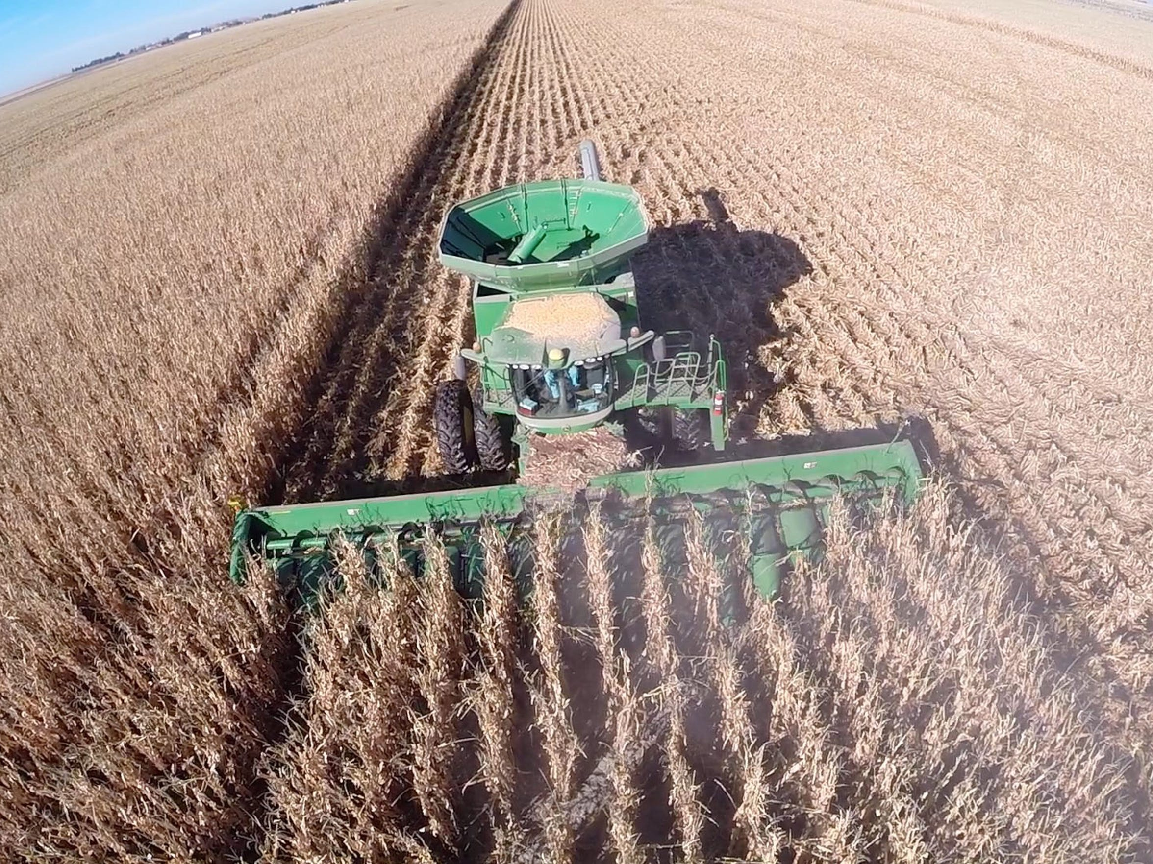 Corn for cattle feed is harvested on the Garetson farm near Sublette, Kansas. Jared Garetson, 17, flies his drone to capture the action. He says he's concerned that if the severe depletion of the Ogallala Aquifer continues unchecked, it will be increasingly difficult to keep irrigating the area's farmland in the future.