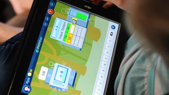 Kyra Gurath, 6, plays DreamBox Math on the iPad at her home in eastern Sioux Falls on Friday, Oct. 24, 2014.