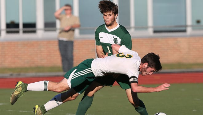 Hastings Will Berritt (3) collides with Spackenkill's Gaetano Citera (11) as he goes after the ball during the boys soccer semi-final at Lakeland High School in Shrub Oak on Wednesday. Hastings won the game 3-1.