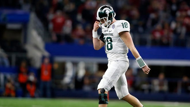 Michigan State Spartans quarterback Connor Cook (18) walks off the field in the fourth quarter against the Alabama Crimson Tide in the 2015 CFP semifinal at the Cotton Bowl at AT&T Stadium.