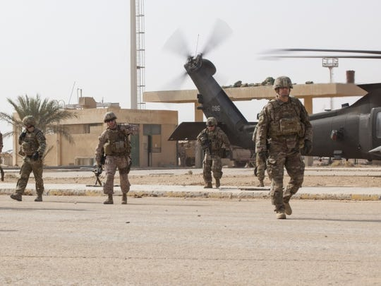 """Leaders with the 1st Armored Division, including Maj. Gen. Robert """"Pat"""" White and Command Sgt. Maj. Danny Day, arrive at a tactical assembly area near Al Qaim, Iraq. The 1st Armored Division headquarters is in Iraq in a mission command role and leads the Combined Joint Forces Land Component Command."""