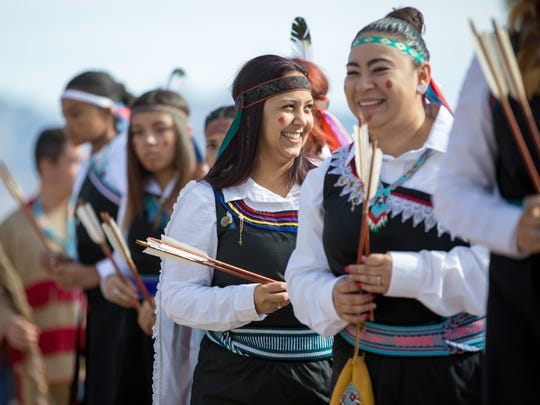 Angela Gonzalez, center, and Amanda Gomez have a laugh together between dances on Monday, Dec. 12, 2016, during the Fiesta of Our Lady of Guadalupe in Tortugas, New Mexico.