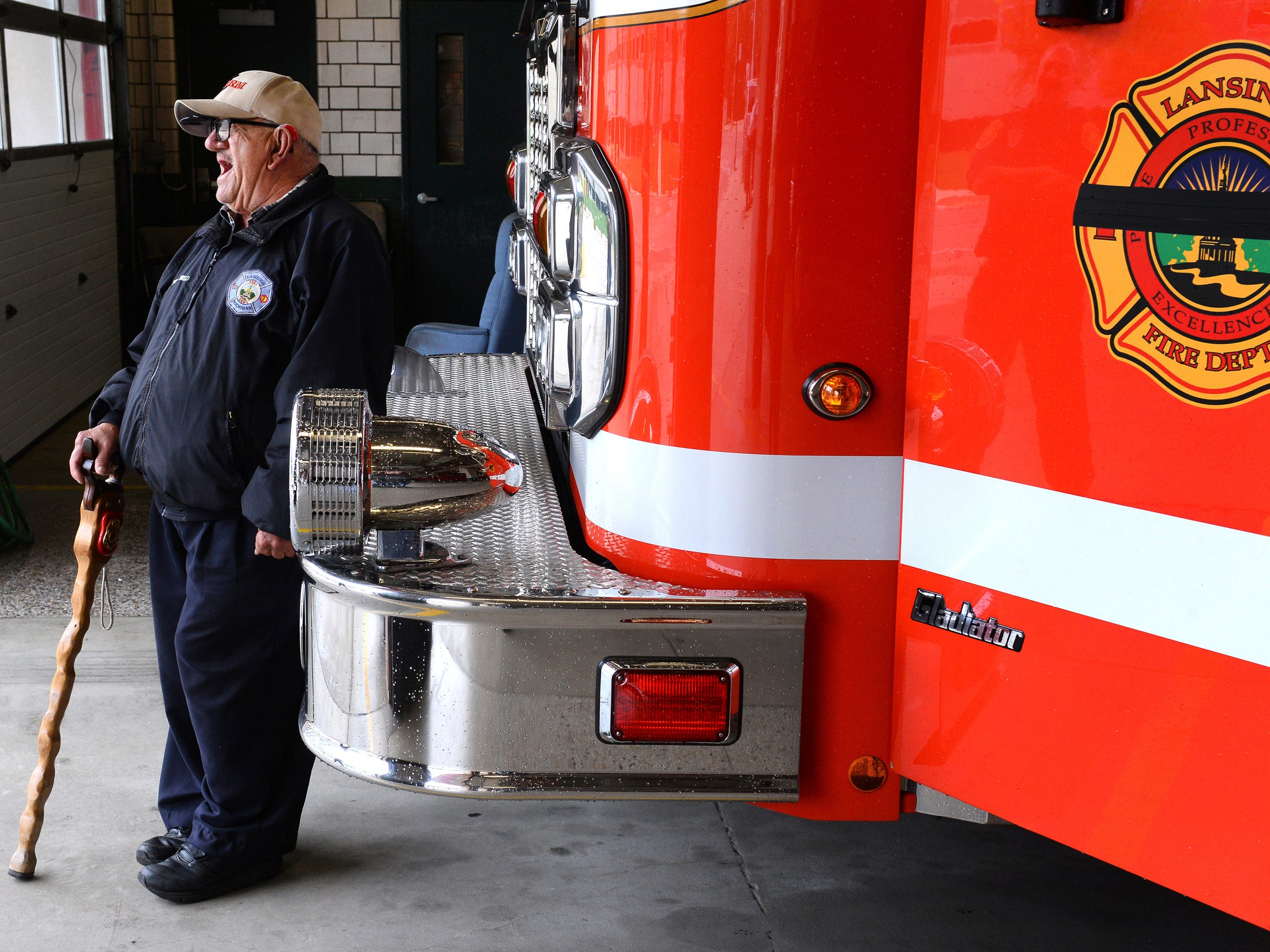 """Tony watches traffic pass on Grand Avenue.  """"We treat him like family,"""" says acting engineer Lisa McRae. """"To us, he is like family. Station life wouldn't be the same without him."""""""