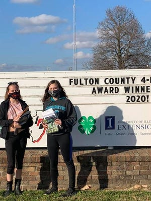 Victoria (left) and Isabella Cooper were two of the many 4-H members who received awards at the 4-H Achievement Open House on November 8.