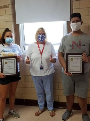 Barnstable Recreation Director Patti Machado, center, gives a thumbs-up to Emily Robinson and Henri Fajardo, the Leisure Program and HYCC employees of the year.