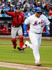 Nationals catcher Matt Wieters, left, throws out Mets' Rene Rivera (44) during the seventh inning of a baseball game Saturday, April 22, 2017, in New York.