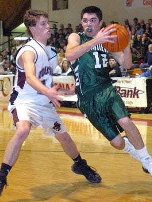 Kyle Nadeau drives to the basket for Bartlett against a Quaboag defender during the 2006 Clark Tournament.
