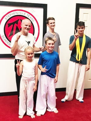 Members of Stephenville's TNT School of Self Defense competed in a virtual reality taekwondo tournament Saturday. Pictured are (front, from left) Karlee King, Kade King, (back) instructor Troy Smith, Ryan Leseberg and Nolan Miller.