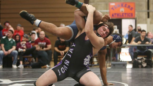 John Jay's Halil Gecaj on his way to defeating Rye Country Day School's Richard Antoine in the 220-pound weight class at the Westchester County Wrestling Championship at Yonkers High School Jan. 20, 2018.
