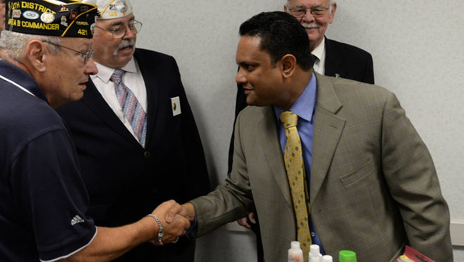 American Legion Commander Post 421 Don Vallery greets Toby Mathew, Overton Brooks VA Medical Center interim director, during a news conference in 2014.