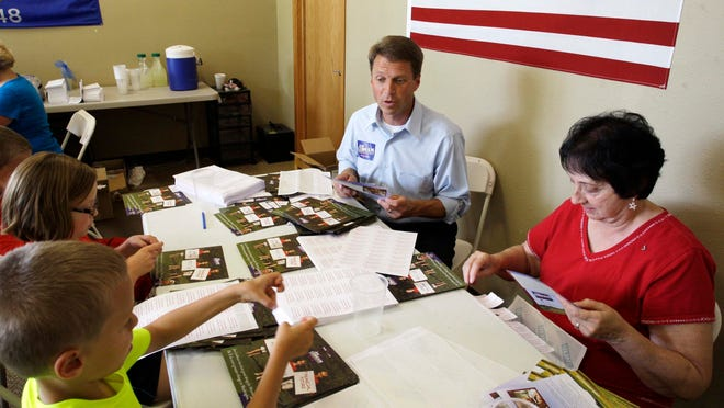 Joe Leibham works inside his campaign headquarters in the Town of Sheboygan on Friday.