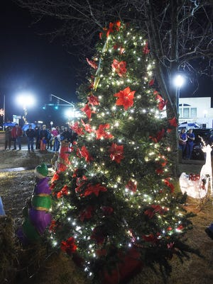 In this file photo, the Christmas tree shines with lights following the Christmas tree lighting ceremony at the Baxter County Courthouse.