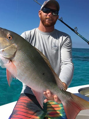 Mutton snapper, like this one rfom Off the Chain fishing charters out of Sailfish Marina in Stuart, which was released by the angler, are being caught in good numbers on Treasure Coast reefs.