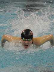 Red Devil sophomore Maddie Shiess emerges from the