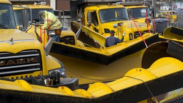 PennDOT plow operators hook up plows in Manchester Township in 2014