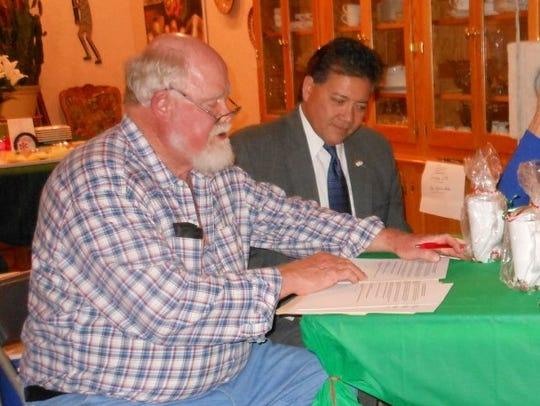 Las Cruces Mayor Ken Miyagishima, right, and Hale Huber