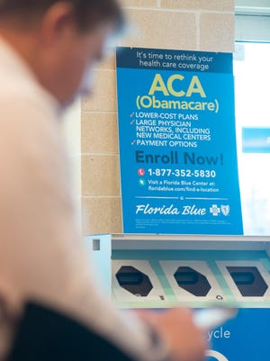 An ACA (Obamacare) sign is displayed at the Florida Blue center in Pensacola on Wednesday, November 16, 2016.