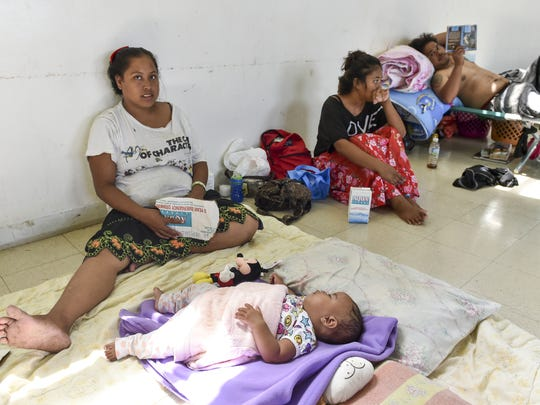 Kaleshia Elieishar, left, and her daughter Shylene, nine months, take shelter in the Kagman Community Center on Aug. 13, eleven days after their home in Saipan was destroyed by Typhoon Soudelor.