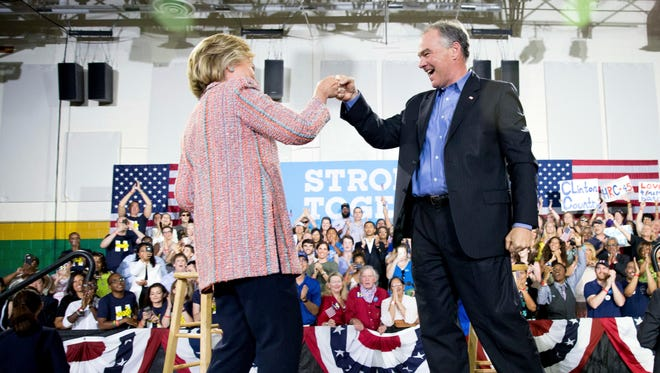 Hillary Clinton fist-bumps Sen. Tim Kaine, D-Va., after speaking at a rally in Annandale, Va., on July 14, 2016.