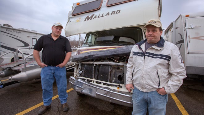 Scott Doyle, left, and Steve Duffey were in Duffey's RV in January when a Metro driver crashed into them on Beechmont Avenue. The bus driver had a suspended driver's license at the time.  Photo: The Enquirer/Liz Dufour