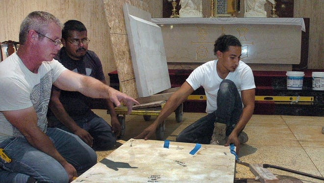 A new altar begins to take shape after its arrival at St. Landry Catholic Church Thursday. A Houston-based installation crew worked for 15 hours straight to assemble and position the stone altar. It will be consecrated during the 10 a.m. Mass Sunday.