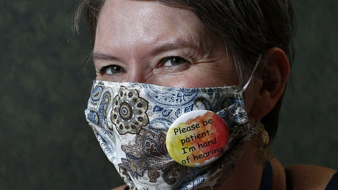 Amy Bull, who is hard of hearing, wears a button on her mask which tells people she is hard of hearing on Wednesday, July 22, 2020.