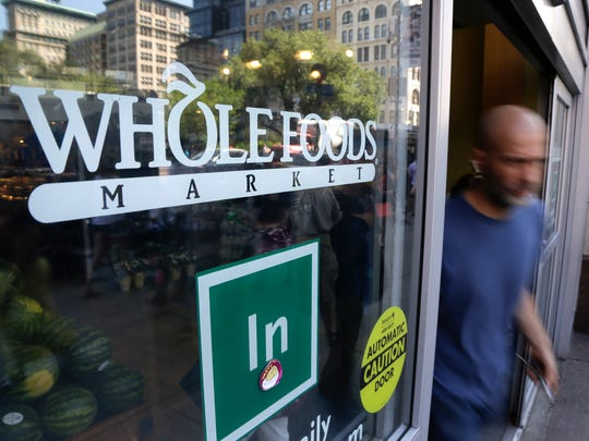 A shopper leaves a Whole Foods Market store in New York's Union Square.
