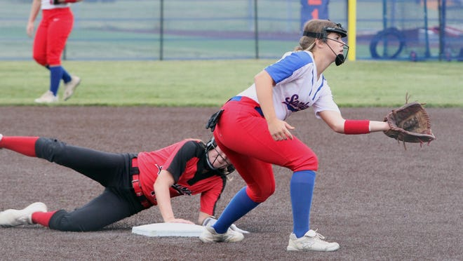 Hannibal sophomore Chloé Simms safely steals second base in the top of the fourth inning Tuesday while Moberly sophomore shortstop Kennedy Messer prepares to gove the throw toward the bag. The Lady Spartans lost 8-7 at home.