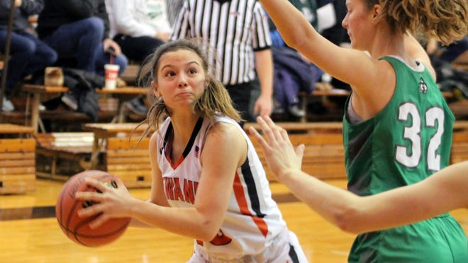 Kewanee's Carley Crabtree (10) looks to pass over Geneseo's Alicia Mackey (32) during the Martin Luther King Invitational at the National Guard Armory.
