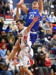 The Falcons' Cole Laney goes up and over the Cedars'