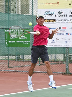 Takao Suzuki competes against Gengo Kikuchi in the King's Delta Guam Futures 2015 held at Guam Hilton Resort and Spa on May 31.Lori Francisco/Pacific Daily News/lfrancisco@guampdn.com