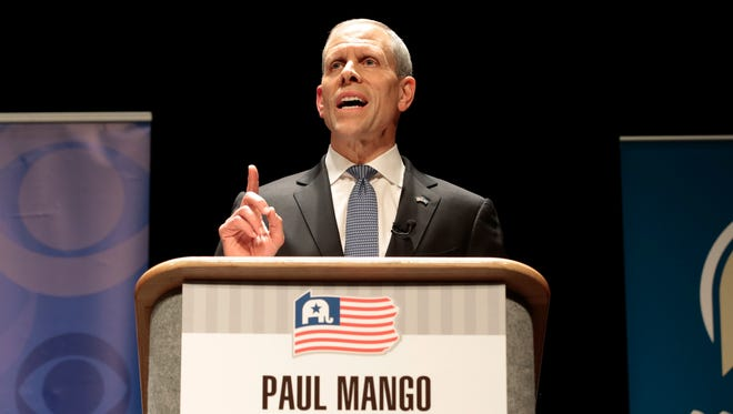 Republican gubernatorial candidate Paul Mango making a point, probably about bathrooms. (AP Photo/Chris Knight)