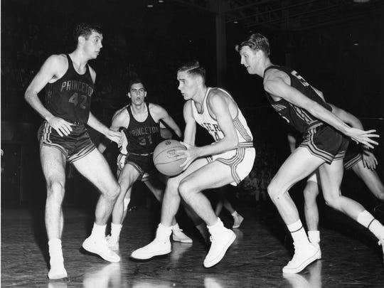 Bob Lloyd (center, with ball) was often triple teamed when he played for Rutgers.