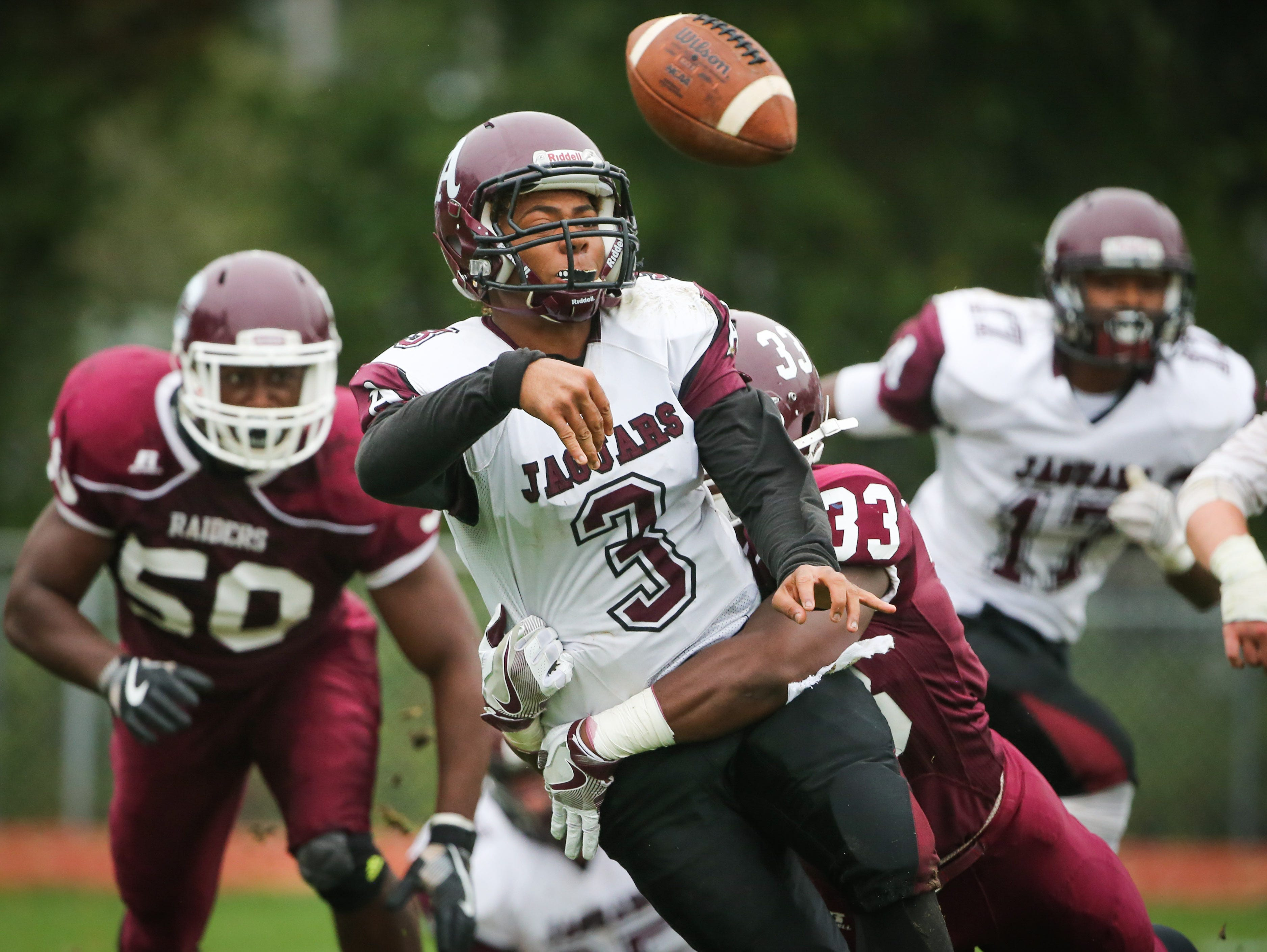 Concord's Byron Simpson hits Appoquinimink quarterback Kenyon Yellowdy as Yellowdy gets rid of the ball. The Raider defense held the Cougars scoreless in a 30-0 win.