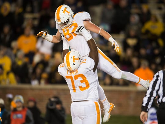 Tennessee offensive lineman Trey Smith (73) lifts tight end Ethan Wolf (82) in the air after he scored against Missouri on Nov. 11.
