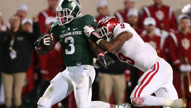 Michigan State's LJ Scott scores a touchdown against Indiana during the second half of MSU's win Saturday in East Lansing.