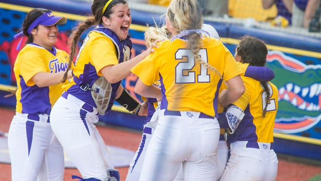 The LSU softball team celebrates after defeating Arizona State to advance to the Super Regionals Sunday.