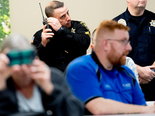 A Loudon County Sheriff monitors the scanner during
