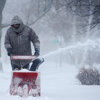 Jeff Thomas uses a snowblower to clear the sidewalk near his house during Tuesday's blizzard, Feb. 2, 2016, in Sioux Falls.