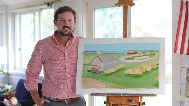 Sam Wilson shows an unfinished painting his mother, Elizabeth Mumford, had been working on before she died, part of a series featuring all the villages in Barnstable. This painting is of the West Barnstable racetrack.