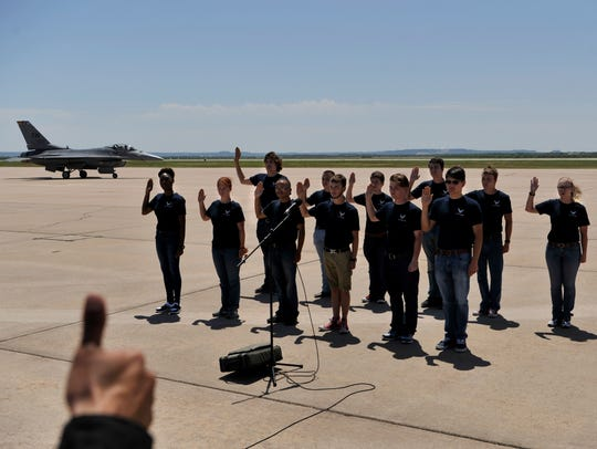 New U.S. Air Force recruits are given the thumbs-up after enlisting on the flight line during the Dyess Big Country Air & Space Expo.
