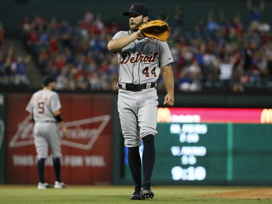 Tigers pitcher Daniel Norris (44) calls for a new ball in the first inning against the Rangers on Sept. 29, 2015, in Arlington, Texas.