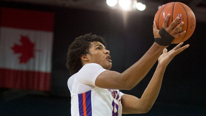 University of Evansville's Dru Smith (12) shoots a layup as the University of Evansville Purple Aces take on the Southeast Missouri Redhawks at the Ford Center in Evansville, Ind., on Thursday, Nov. 16, 2017. The Purple Aces won 66-50.