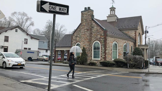 A pedestrian uses a crosswalk to cross Main Street in New Paltz on Thursday. Officials are considering whether a reduced speed limit or more crosswalks would reduce the number of pedestrians hit on Main Street, which has risen sharply in the past two years.