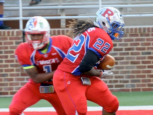 Robert E. Lee graduate Javon Chisley takes a handoff on Friday at the Virginia High School Coaches Association all-star football game at Liberty University.