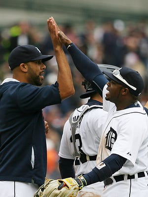 Tigers pitcher David Price celebrates with centerfielder Rajai Davis after the Tigers beat the Twins, 4-0, in Opening Day at Comerica Park on Monday.