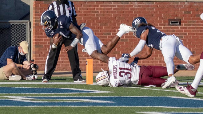 Georgia Southern quarterback Shai Werts (1) dives into the end zone for one of his three first-half touchdowns on Saturday against Texas State at Paulson Stadium in Statesboro.