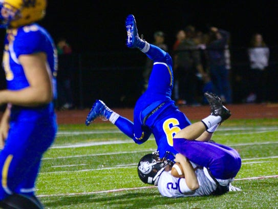 Mifflin County's Drew Williams (2) is brought down